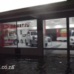 Rain Water laps the entrance to Daihatsu