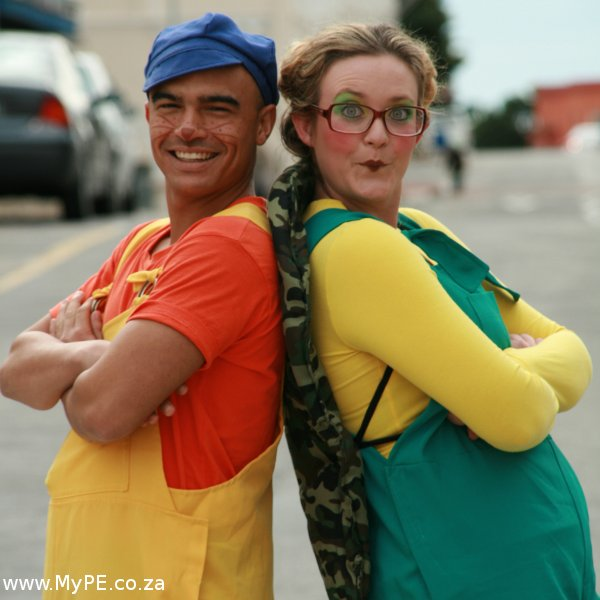 Andrew White as Meerkat and Megan van Wyk as Tortoise.