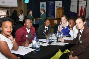 Beyond the Classroom facilitator Zenaude Nkaelo (NMMU – left) with matric girls from the different schools all seated at one table to facilitate networking are from the left Khanyisa Kolih (Ethembeni Enrichment Centre), Ntombi Mshumpela (Lawson Brown High School), Simone Smith (Andrew Rabie), Yolanda Mfeti (Walmer High School) and Tarryn Wright (Alexander Road High School). PHOTOGRAPHER: Gerdie de Lange