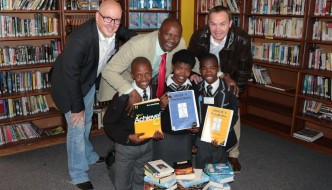 From top left is Mr. Lunga Dyani (Principal of Walmer High School) and Dave Tiltmann (Managing Director of Algoa FM) with Walmer High School library prefects from bottom left is Samkelo Koli (gr 11), Banathi Adams (gr 11) and Anathi Mqongwana (gr 10)