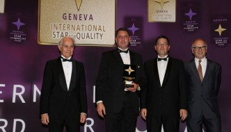 John Roberts, Just Property Group CEO, second from left, picks up the award in Geneva