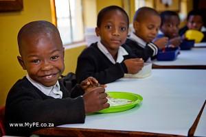 Khaya Mbi from Funimfundo Primary School in Port Elizabeth tucks into a hearty breakfast