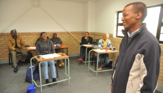 SKILLS DEVELOPMENT: The Coega Development Corporation (CDC) chief executive Pepi Silinga pays a visit to building inspector trainees at the CDC's Skills Development Centre in Port Elizabeth. The CDC started the course after it identified a gap in the market.