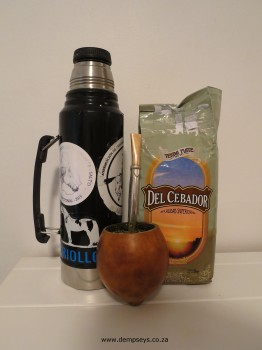 water flask, calabash with bombilla and bag of mate tea