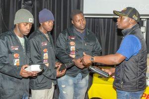 Filpro's Project Co-ordinator Mduduzi Mahlalela (right) demonstrating the use of automotive product to Kwano Auto Repairs' mechanics Mark Mkayo, Phanbulwazi Magqaza and Sipho Mkayo.